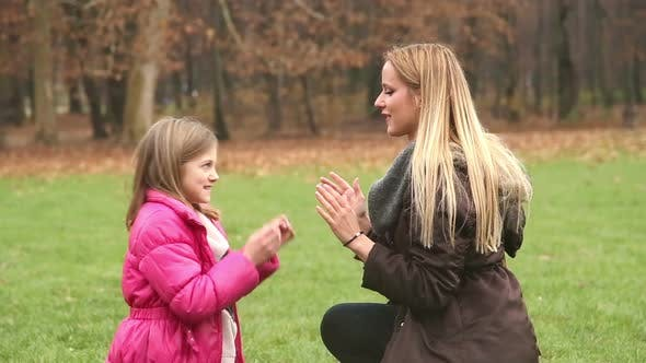 Thumbnail for Mother And Daughter Playing Clapping Game