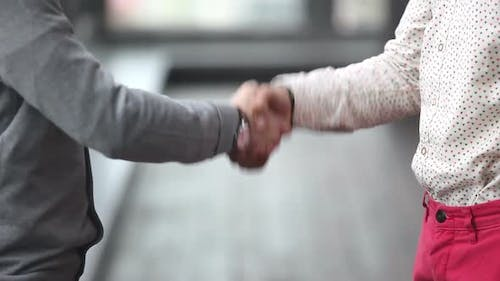 Two Advertising Executives Shaking Hands