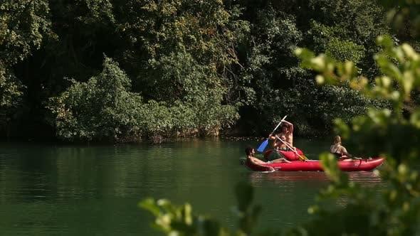 Thumbnail for Friends Enjoying Paddling In Canoe On River 2