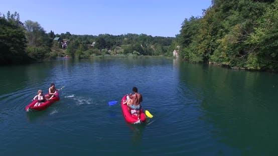 Thumbnail for Friends Having Fun Paddling Canoe