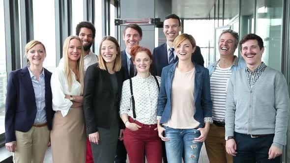 Thumbnail for Portrait Of Business And Advertising Team, Looking At Camera And Laughing