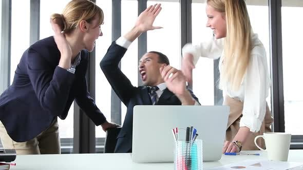 Thumbnail for Young Manager And Two Businesswoman With Laptop, High-Fiving And Cheering 2