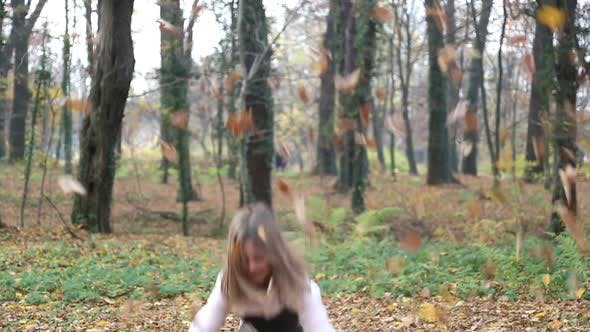 Thumbnail for Girl Having Fun Throwing Leaves And Jumping In The Park