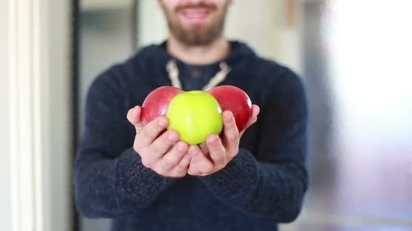 Thumbnail for View Of Man Hands Holding Apples 1
