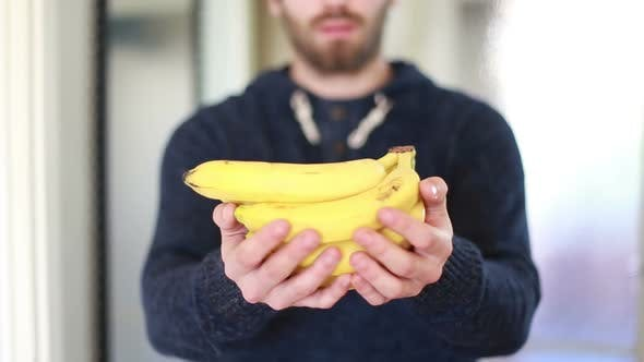 Thumbnail for View Of Man Hands Holding Bananas