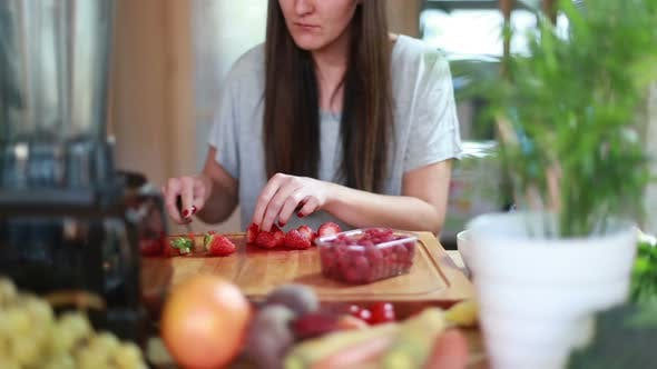Thumbnail for Young Woman Cutting Strawberries 1