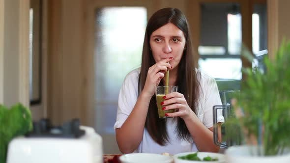 Thumbnail for Young Woman Drinking Green Smoothie