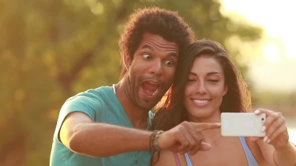 Thumbnail for Young, Beautiful Couple Taking A Funny Selfie 1