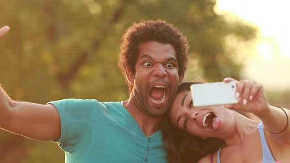Thumbnail for Young, Beautiful Couple Taking A Funny Selfie 2