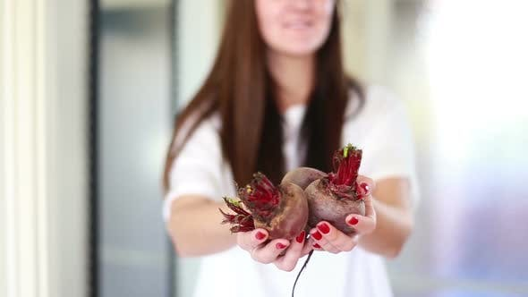 Thumbnail for View Of Woman Hands Holding Beetroots