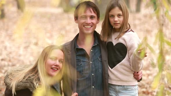 Thumbnail for Portrait Of Young Family Looking And Smiling