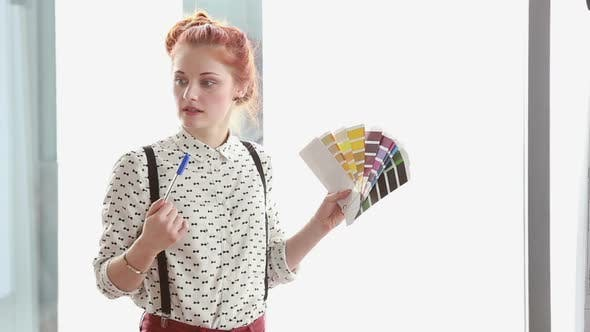 Thumbnail for Beautiful Red Hair Woman Holding Color Fan Deck During Presentation