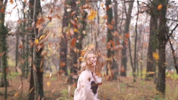 Thumbnail for Happy Girl Having Fun Throwing Leaves In The Air 1