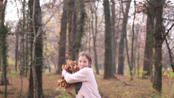 Thumbnail for Happy Girl Having Fun Throwing Leaves In The Air 2