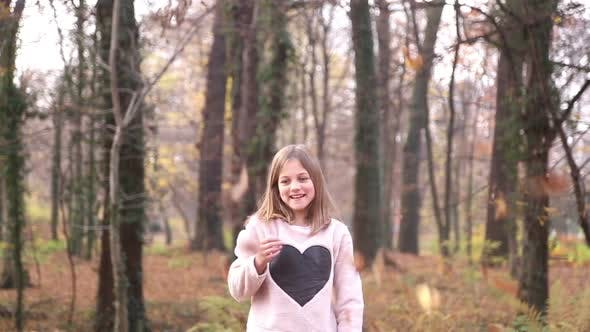 Thumbnail for Happy Girl Having Fun Throwing Leaves In The Air 3