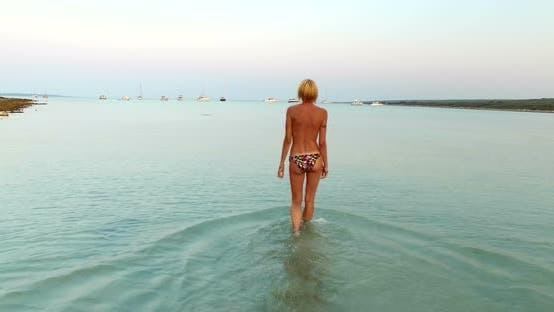 Thumbnail for Woman Entering Into Sea At Slatinica Beach, Croatia 1