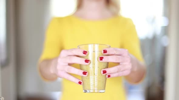 Thumbnail for Woman Hands Holding Glass Of Smoothie