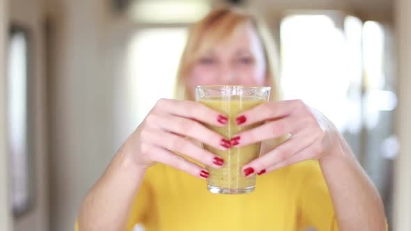 Thumbnail for Woman Holding Glass Of Smoothie