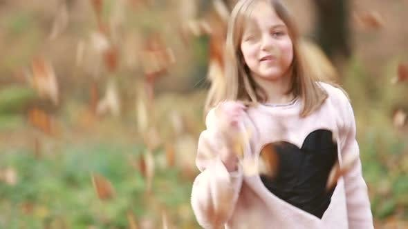 Thumbnail for Cute Girl Throwing Leaves In Park 2
