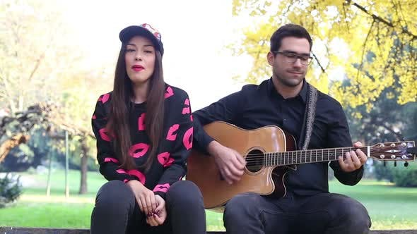 Thumbnail for Beautiful Woman Singing While Handsome Man Playing Guitar 10