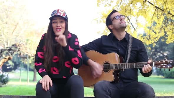 Thumbnail for Beautiful Woman Singing While Handsome Man Playing Guitar 9