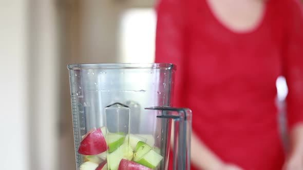 Thumbnail for Woman Putting Fruit Into Blender 3