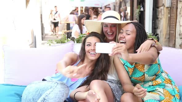Thumbnail for Beautiful Young Women Having Fun Taking Selfies In Town 4