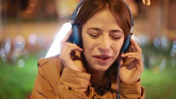 Thumbnail for Blonde Girl Shaking Her Head To The Rhythm Of Music With Headphones