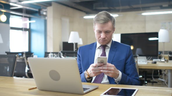 Thumbnail for Businessman Typing Text Message on Smartphone