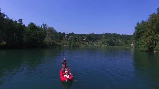 Thumbnail for Aerial View Of Friends Having Fun Paddling Canoe On Mreznica River, Croatia