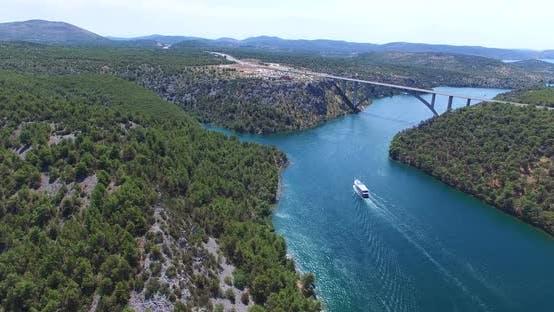 Thumbnail for Aerial View Of Boat Sailing Towards Krka Bridge, Croatia 2