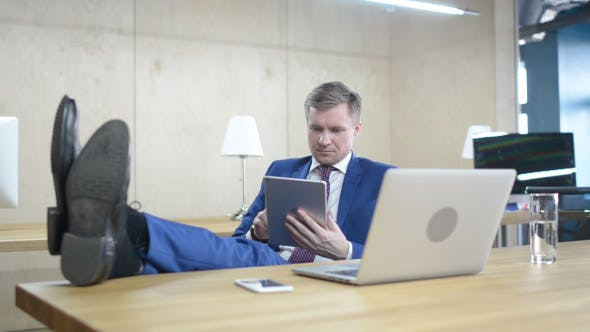 Thumbnail for Relax Businessman Browsing on Tablet