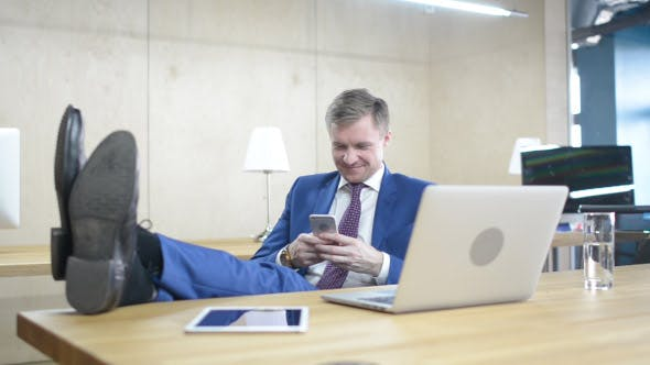 Thumbnail for Text Messaging on Phone, Positive Relaxing Businessman