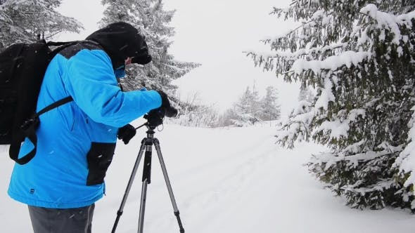 Thumbnail for Photographer In Winter Mountain