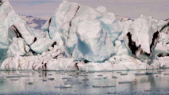 Thumbnail for Camera Moves Along Big Icebergs At Jokulsarlon Iceland