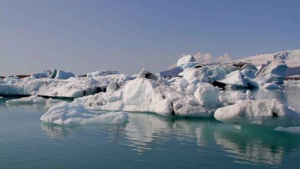 Thumbnail for Camera Moves Around Icebergs At Jokulsarlon Iceland