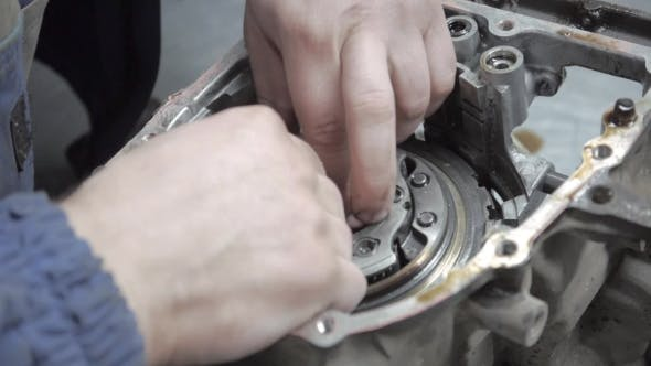 Thumbnail for Auto Mechanic Repairing a Car Engine And  View Of Automatic Robot Transmission