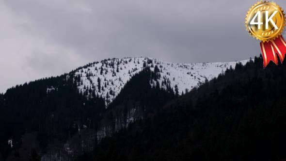Thumbnail for Snow Clouds Moving Across a Snowy Mountain