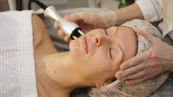 Thumbnail for Young Woman Receiving Electric Facial Massage