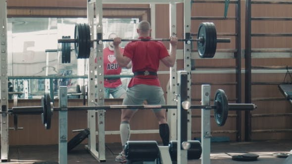 Thumbnail for Olympic Athlete Lift Heavy Weight Bar