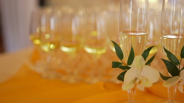 Thumbnail for Decorated Champagne Flutes On Table During Wedding