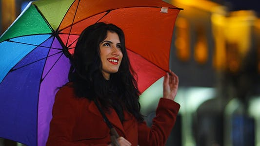 Thumbnail for Happy Woman With Rainbow Multicolored Umbrella