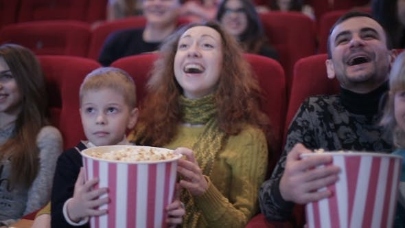 Thumbnail for People Watching Movie In Cinema And Laughing