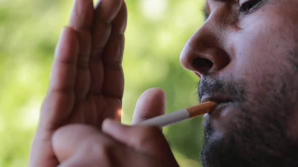 Thumbnail for Dark Indian Man Smoking A Cigarette