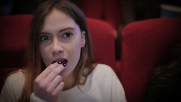 Thumbnail for Teenage Girl Watching Movie In Cinema