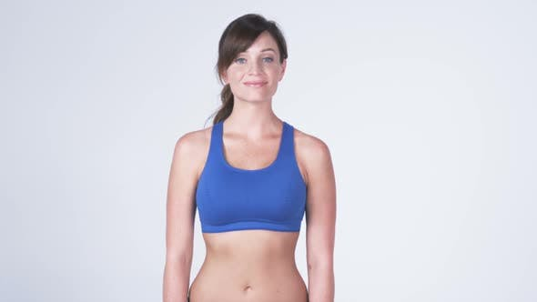 Thumbnail for Front view panning shot down across a woman wearing gym clothes