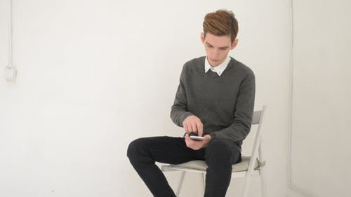 Using Smartphone, While Sitting on Chair