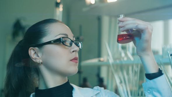 Thumbnail for Woman Researching Flask In a Laboratory