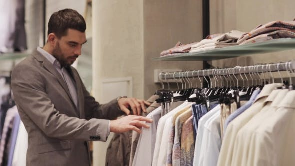 Thumbnail for Happy Young Man Choosing Clothes In Clothing Store 1