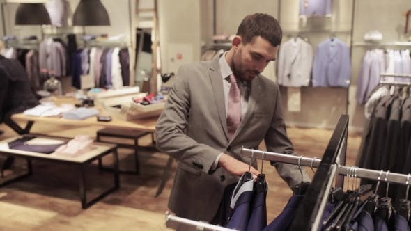 Thumbnail for Young Man Choosing Clothes In Clothing Store 14